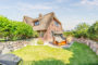 Endhausteil unter Reet mit Terrasse und Garten in Archsum - BILD